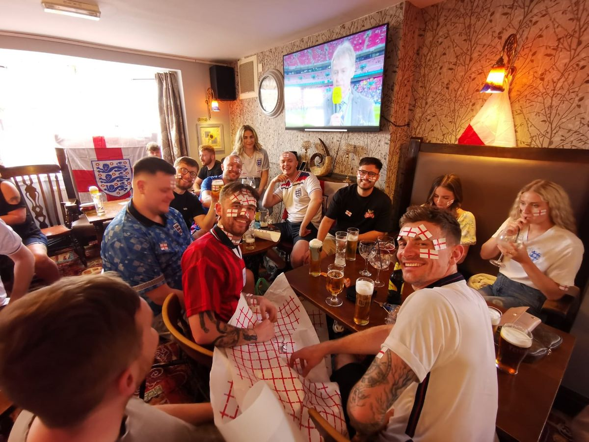 Fans at The Colliers Arms, Cheslyn Hay, go sticker mad as they prepare to watch the match