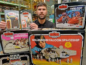 DUDLEY COPYRIGHT TIM STURGESS EXPRESS AND STAR...... 22/10/2020... Astons Auctioneers , Dudley, Star Wars toys auction pre pic this will be the final auction before the new owner takes over. Pictured, Chris Aston with  some of the  original Star Wars toys found in a house in Stoubridge..