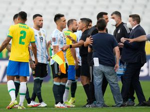 The match in Sao Paolo was suspended after officials came on to the pitch