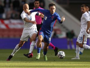 Romania's Vlad Chiriches (left) and England's Jack Grealish