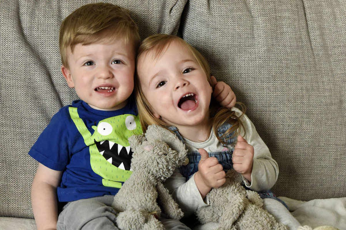 IN PICTURES: Mother shares touching tale of two-year-old helping twin with cerebral palsy