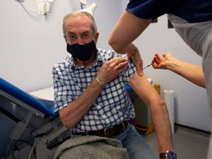 Gerry Hughes, 81, receives the first of two injections with a dose of the Pfizer/BioNtech covid-19 vaccine in Halesowen