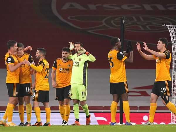 Wolves celebrate victory over Arsenal on Sunday – after talisman Raul Jimenez had been stretchered off with a fractured skull (PA)
