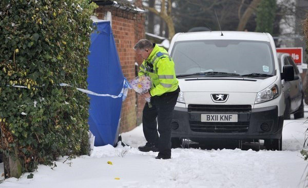 Police at the scene in Doveridge Place