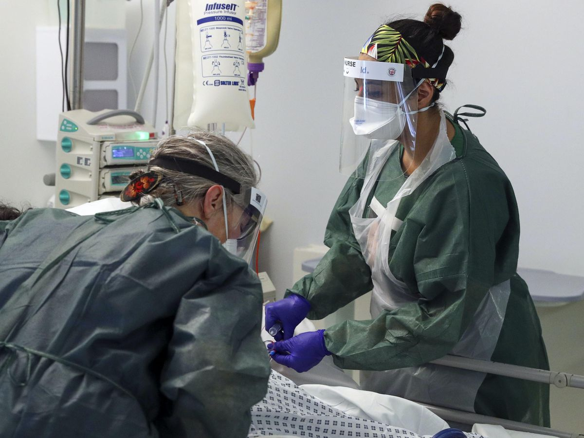 Nurses care for a patient in an Intensive Care ward