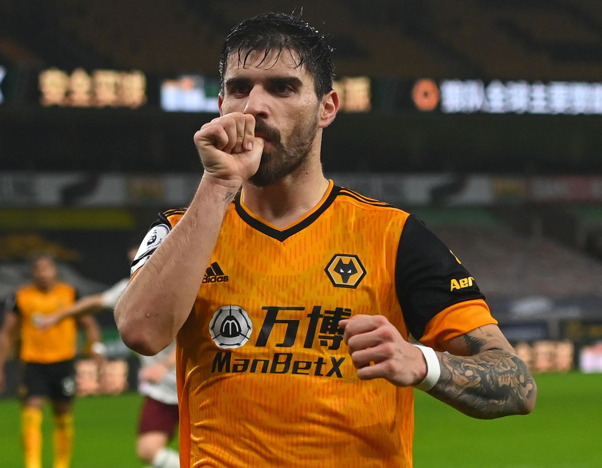 Ruben Neves is set to return for Wolves this weekend after Covid isolation. Below, in the garden with his young son Martim