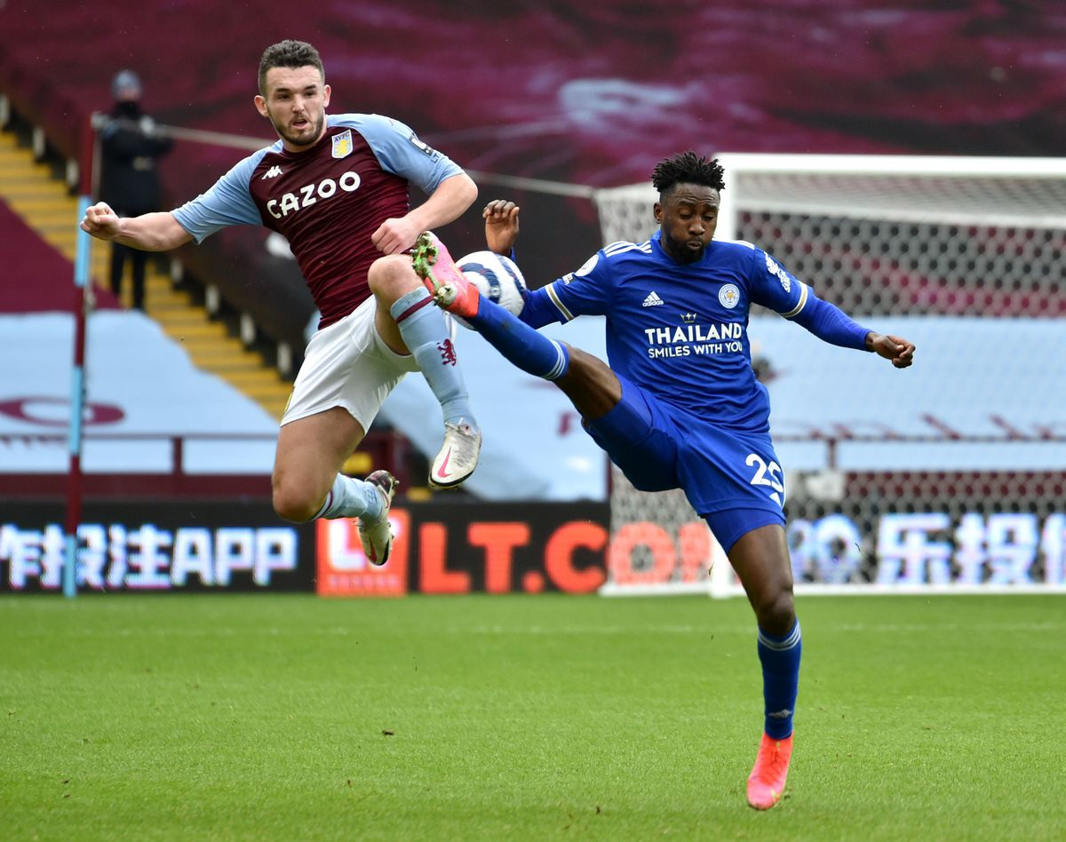 Leicester City's Wilfred Ndidi (right) and Aston Villa's John McGinn (left) battle for the ball