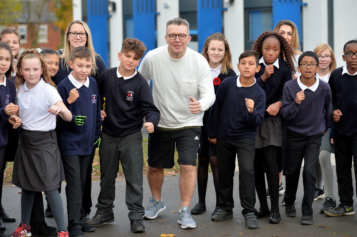 Tom Watson with the school children