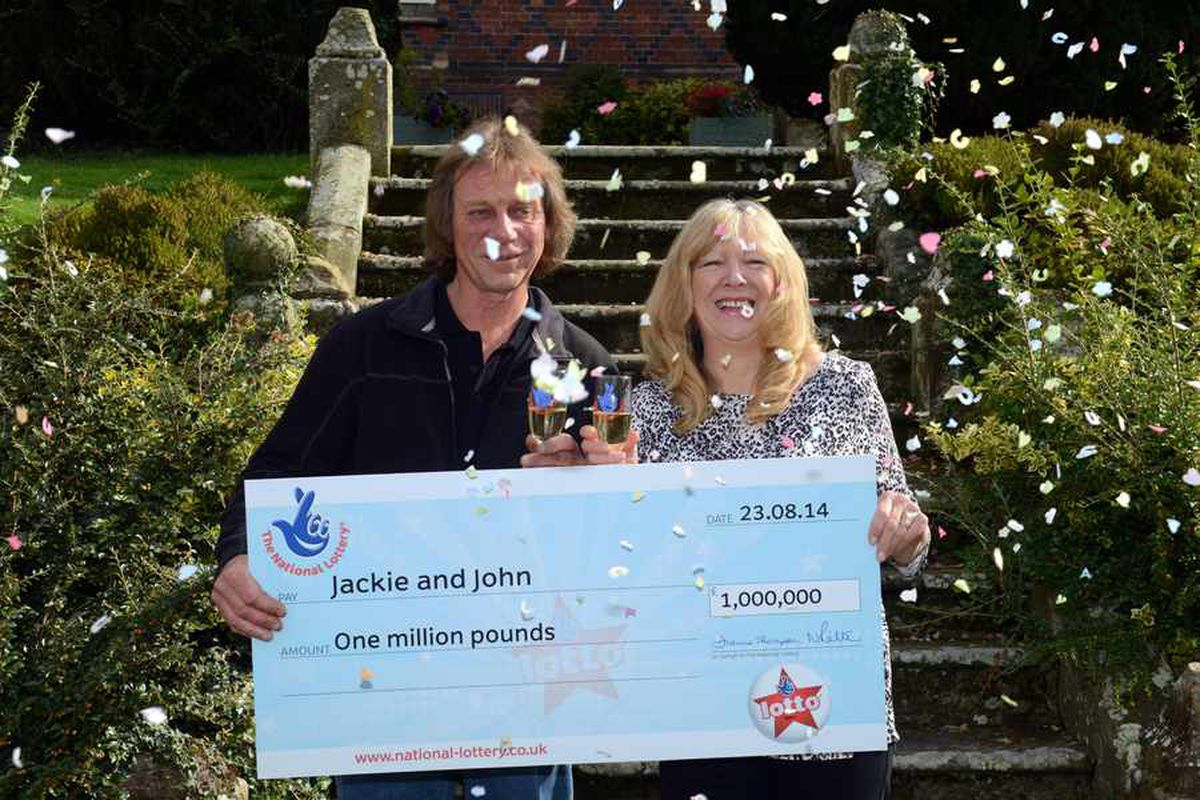 Celebration time: John Potter and Jackie Murphy with their £1 million cheque