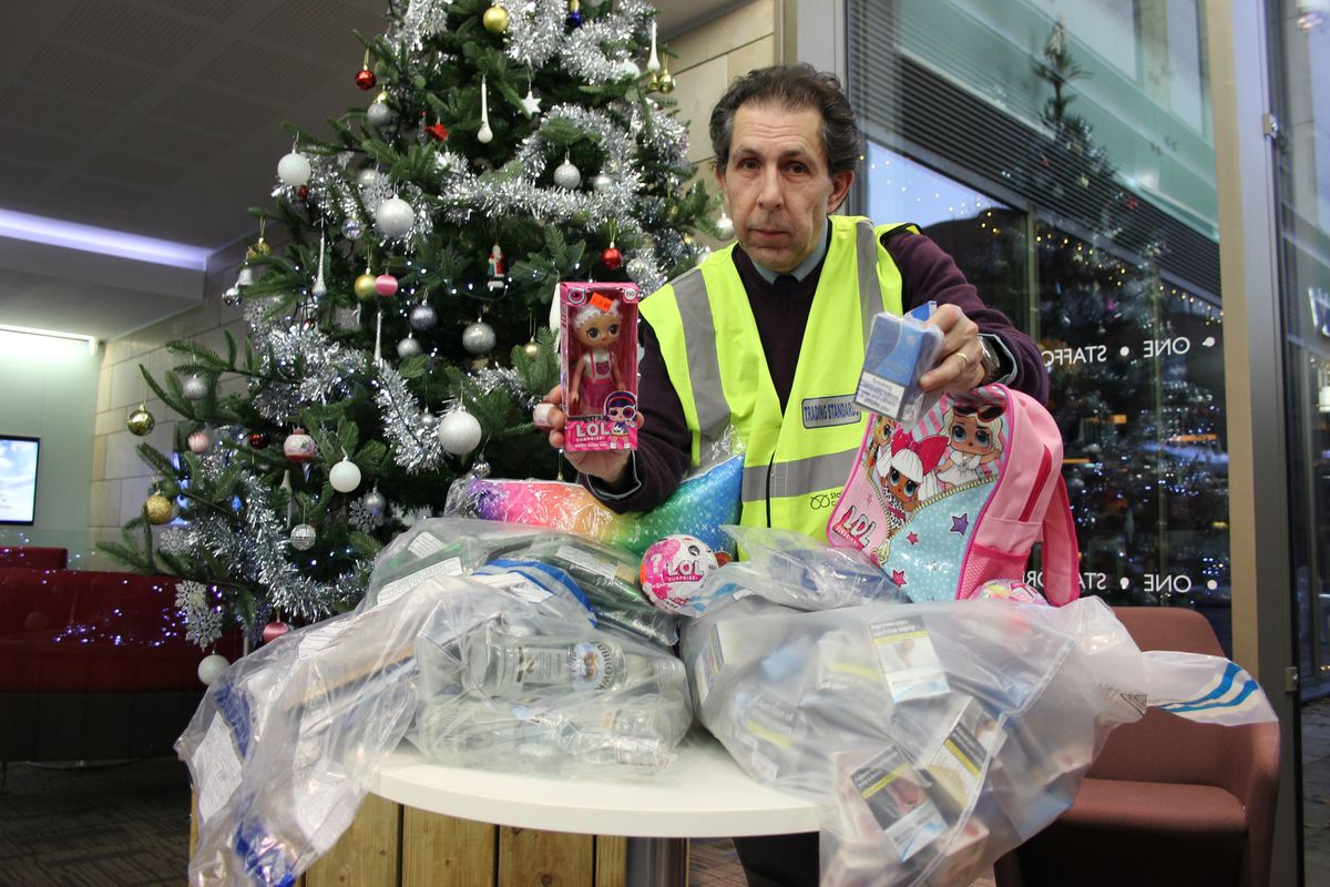 Tony Shore, manager at Staffordshire County Council's Trading Standards team, with the fake items