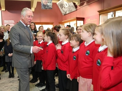 Charles signs slate in support of Truro Cathedral's new roof appeal