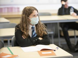 A student wears a protective face mask as the requirement for secondary school pupils to wear face coverings when moving around school comes into effect from today across Scotland (Jane Barlow/PA)