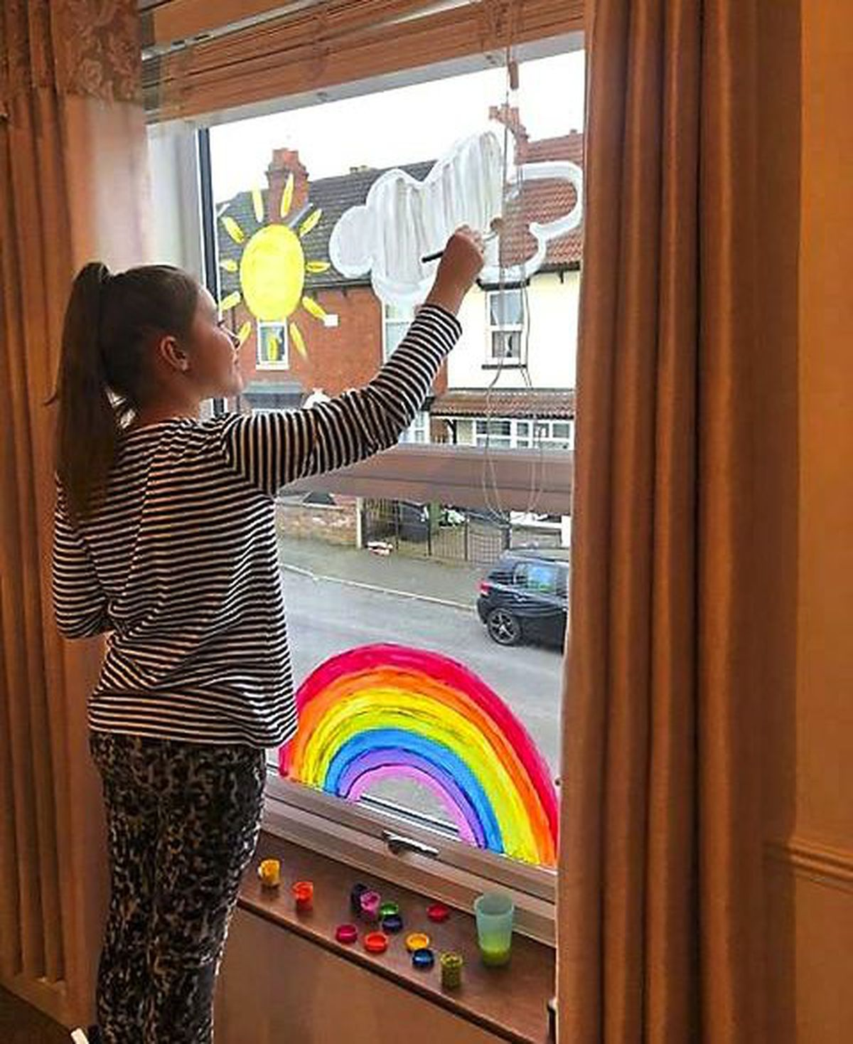 Hannah Hill, aged nine, from Milton Road, Fallings Park, Wolverhampton, with her rainbow design to honour NHS workers