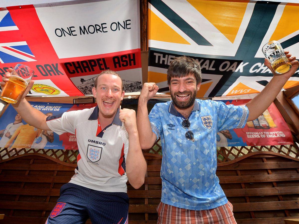 Sam Ward and Isaac Atwal celebrating the win at the Royal Oak Pub in Chapel Ash