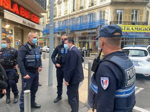 The Mayor of Nice Christian Estrosi with police at the scene where the knife attack took place in Nice