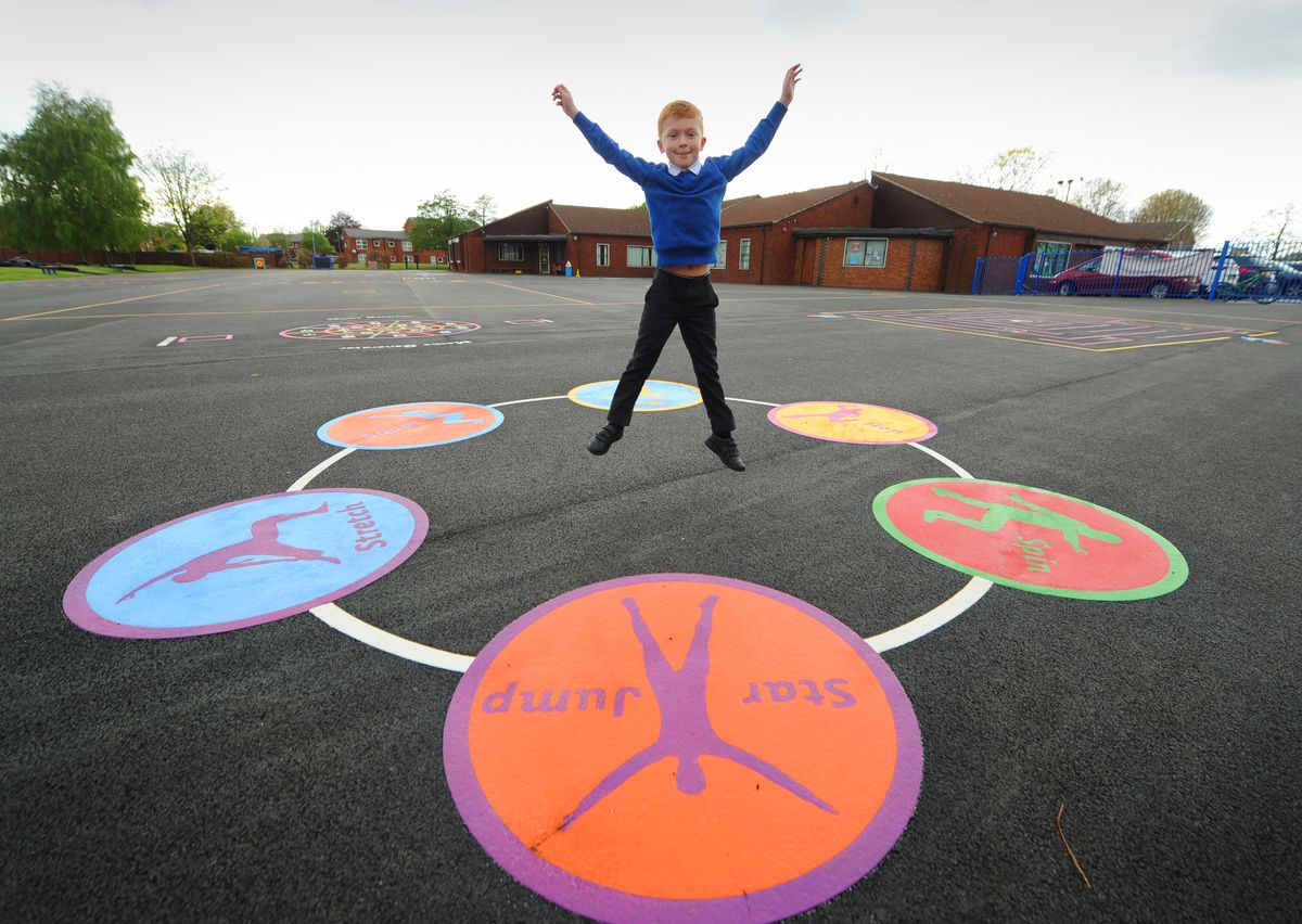 WOLVERHAMPTON PIC/ DAVID HAMILTON PIC / EXPRESS AND STAR PIC 13/5/21 Doing a star jump in the new playground, pupil Lucas Doran, aged 8, at Perton Primary Academy, Perton, Wolverhampton..