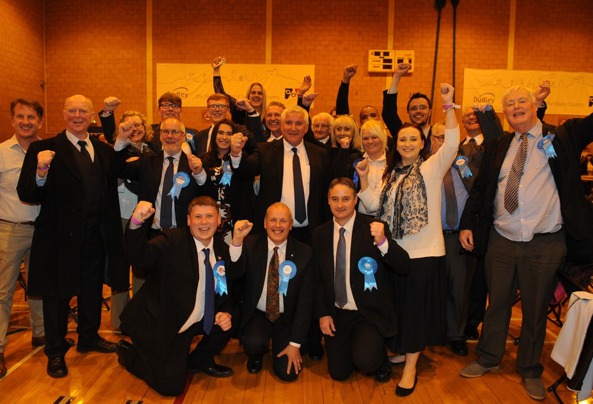 Council leader Patrick Harley, centre, celebrates a good night for the Tories in Dudley