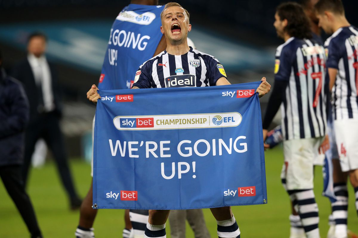 Kamil Grosicki of West Bromwich Albion celebrates promotion to the Premier League on the pitch at the end of the match. (AMA)