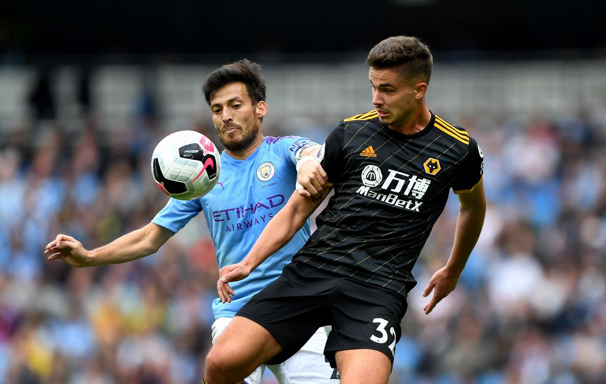 David Silva of Manchester City and Leander Dendoncker of Wolverhampton Wanderers (AMA)