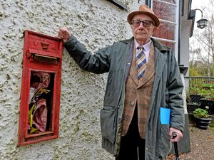 STAFFORD COPYRIGHT TIM STURGESS EXPRESS AND STAR...... 25/11/2020. A postbox, in the wall of the Star Inn, in Eccleshall, has been damaged for 12 months causing annoyance to villagers. Pictured is  villager Peter Allsopp, 80, a former local councillor, who has complained to Royal Mail..