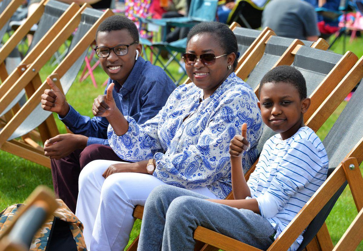 Jacob Kamara, 16, Donna Asiimwe, and Jesse Ayebazibwe, 10, get comfortable before the start of Sonic the Hedgehog