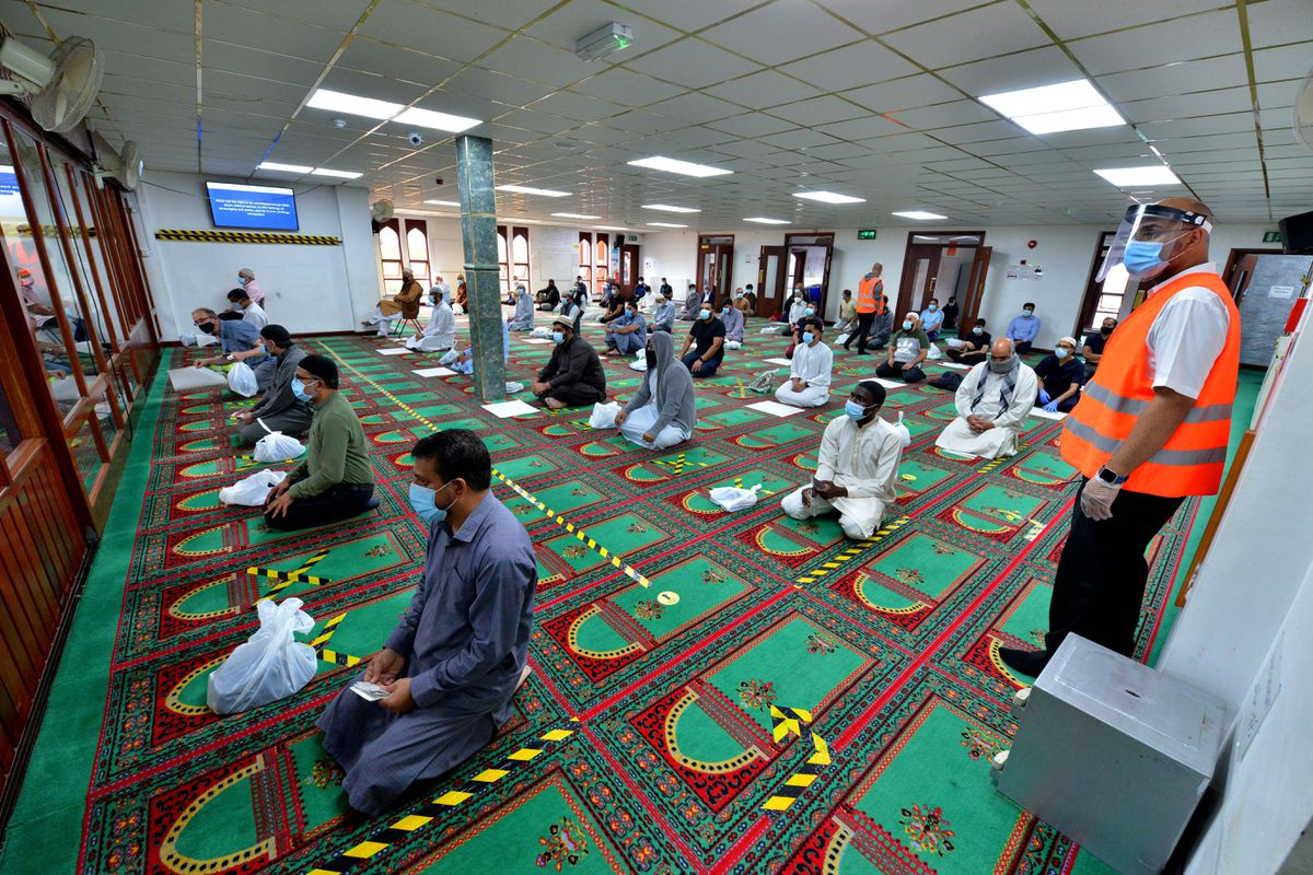 Disposable paper sheets are given to be used by individuals when praying, with clear markings on the floor to ensure social distancing