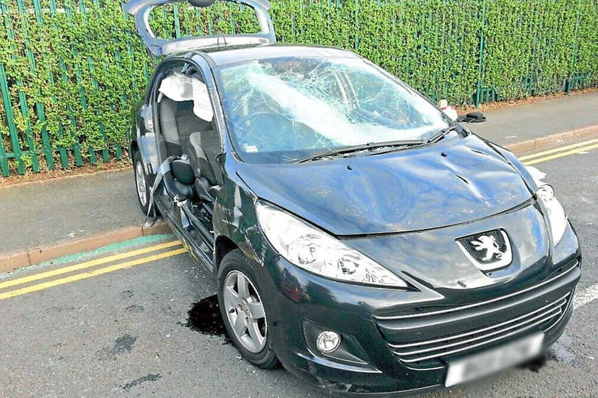 Warning as car flips on to side in Walsall