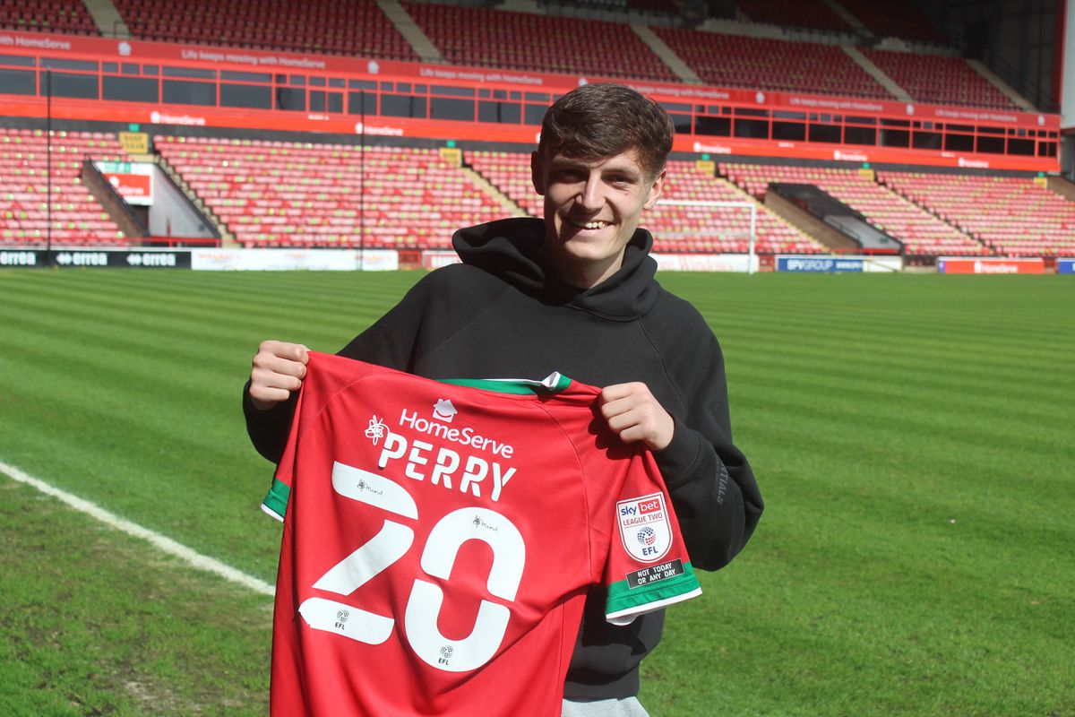 Sam Perry signs his new deal. Picture: Walsall FC