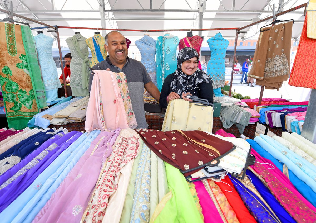 Munir Hassan and wife Nikki were among the smiling stall holders