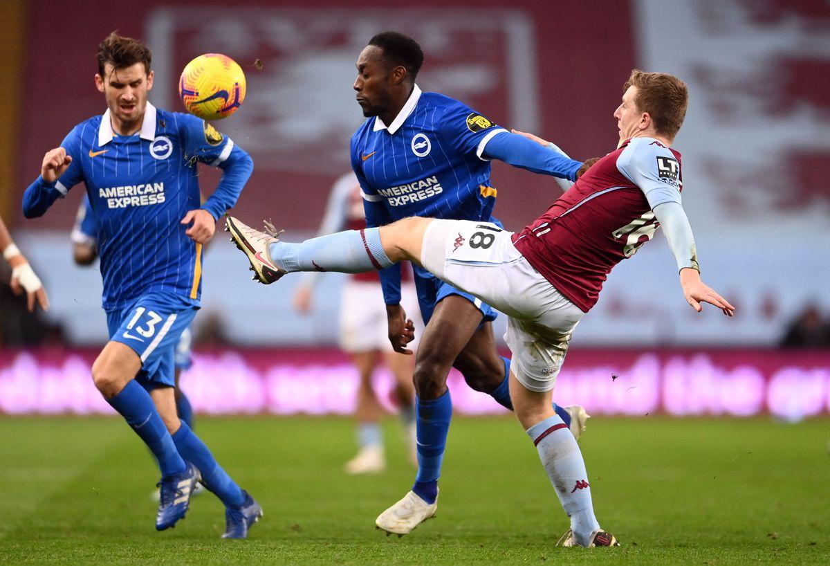 Aston Villa's Matt Targett and Brighton and Hove Albion's Danny Welbeck