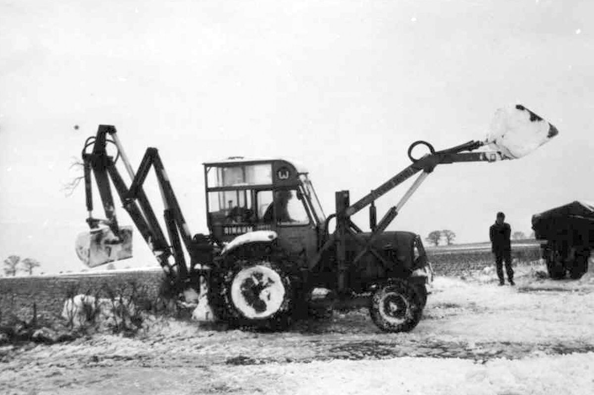 One of David's early diggers clearing snow off the A41 at Crosshills, Sambrook, in 1967.