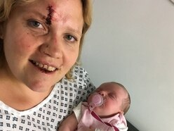 Reunited! Baby back in mother's arms after terrifying car-jacking