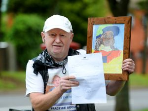Graham Payne with a copy of the painting he sent to Prince William and the letter he got back in response
