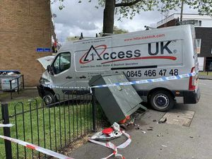 The van went through a telecoms box and railings in the accident