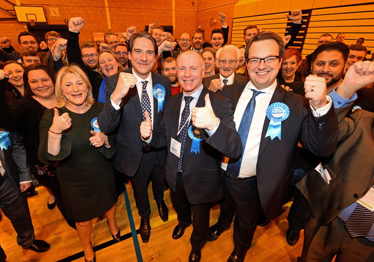 The four Conservative MPs Suzanne Webb, James Morris, Marco Longhi and Mike Wood celebrate in Dudley