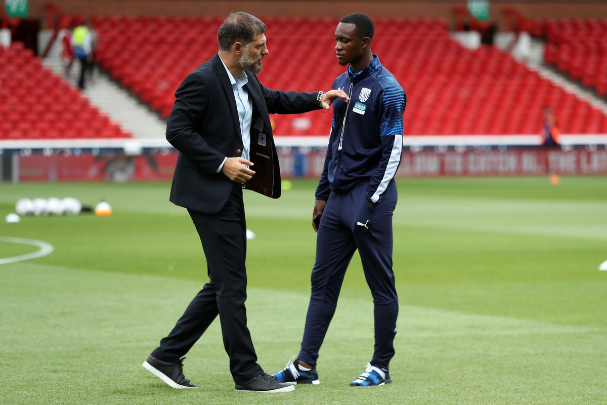 Slaven Bilic head coach / manager of West Bromwich Albion speaks with Rekeem Harper (AMA)