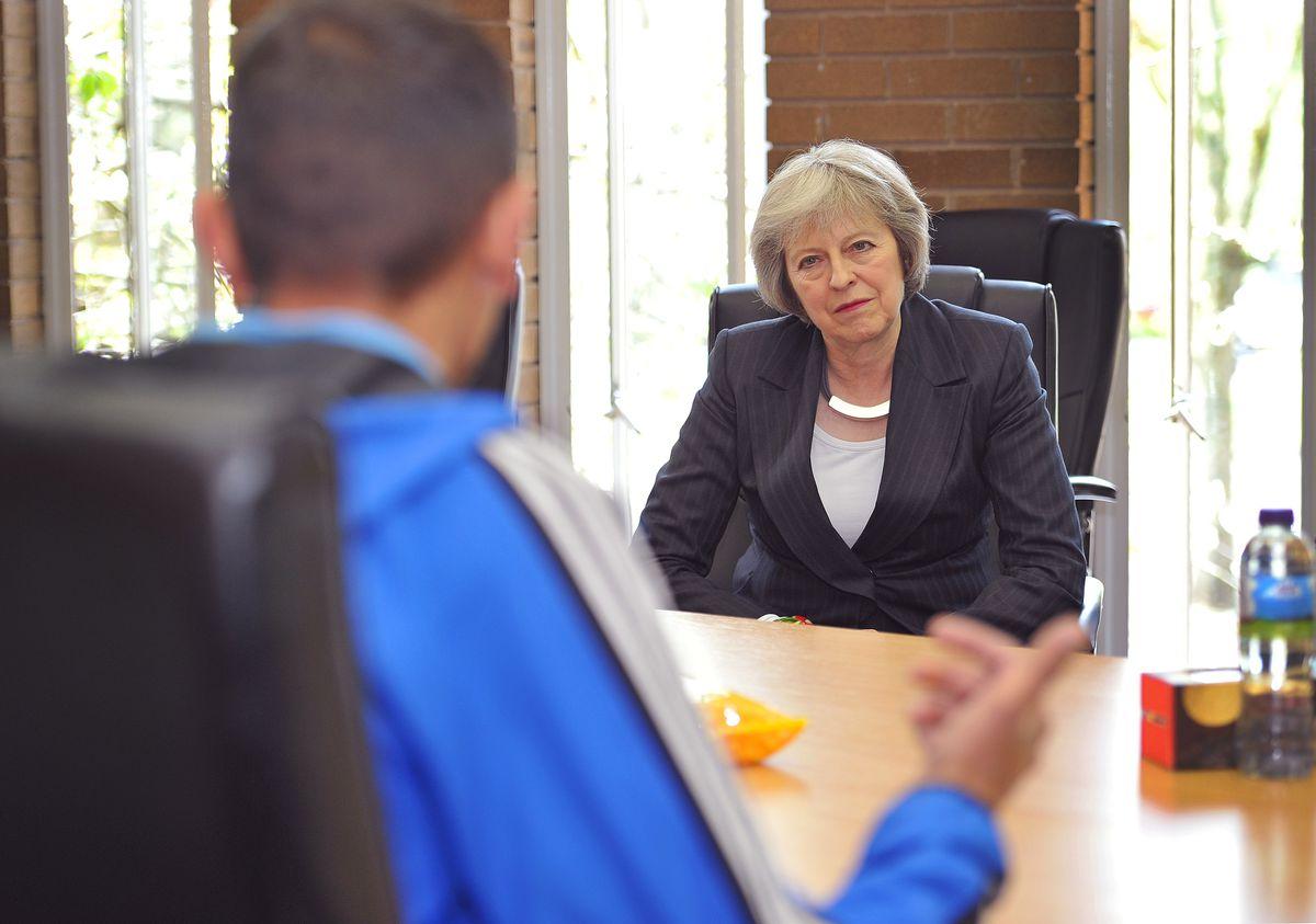Former PM Theresa May chats to former homeless guys Dave Armishaw and Imran Reece Wall