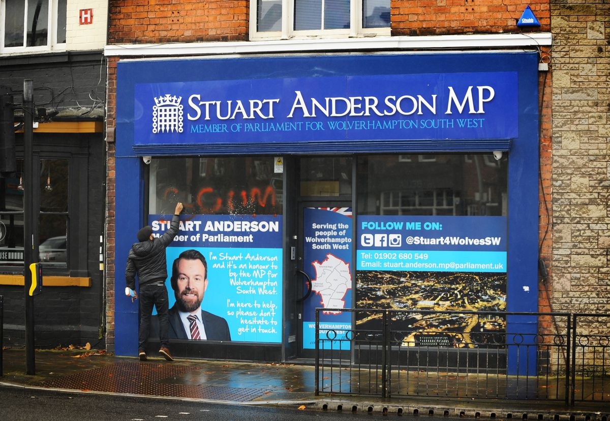 The word 'scum' is cleaned off the constituency office of Stuart Anderson MP