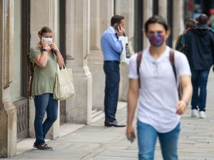 Shoppers wearing face coverings on Regent Street, London, ahead of the announcement that it will soon be mandatory to wear a face covering in shops in England. PA Photo. Picture date: Tuesday July 14, 2020. Health Secretary Matt Hancock will announce today that from July 24 wearing a face covering in shops and supermarkets will be mandatory, and anyone failing to comply with the order could face a fine of up to £100. Enforcement of the regulations will be the responsibility of the police. See PA story HEALTH CoronavirusFaceMasks. Photo credit should read: Dominic Lipinski/PA Wire.
