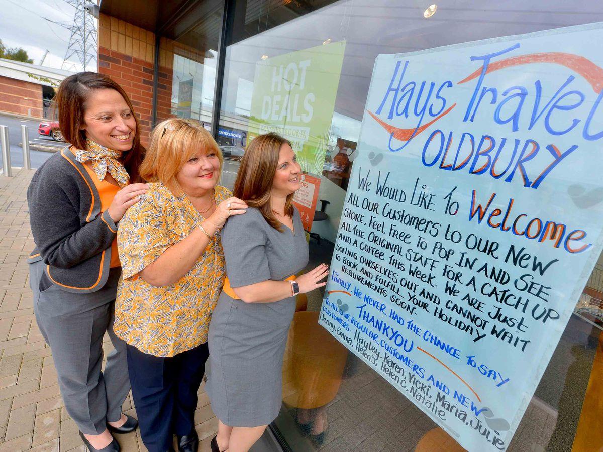 Former Oldbury Thomas Cook staff Emma Bagley, Karen James and Hayley Gulliver celebrate the Hays Travel takeover