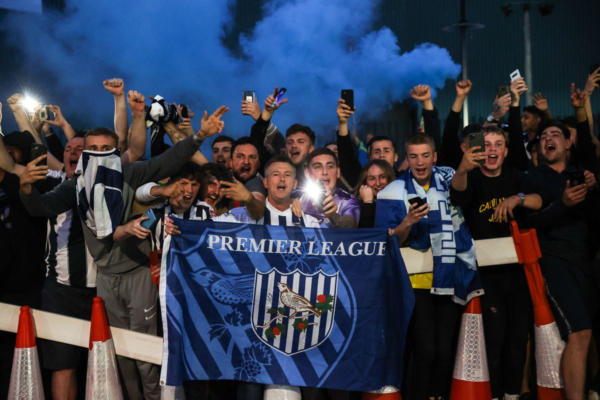 Fans of West Bromwich Albion celebrate promotion outside the stadium. (AMA)