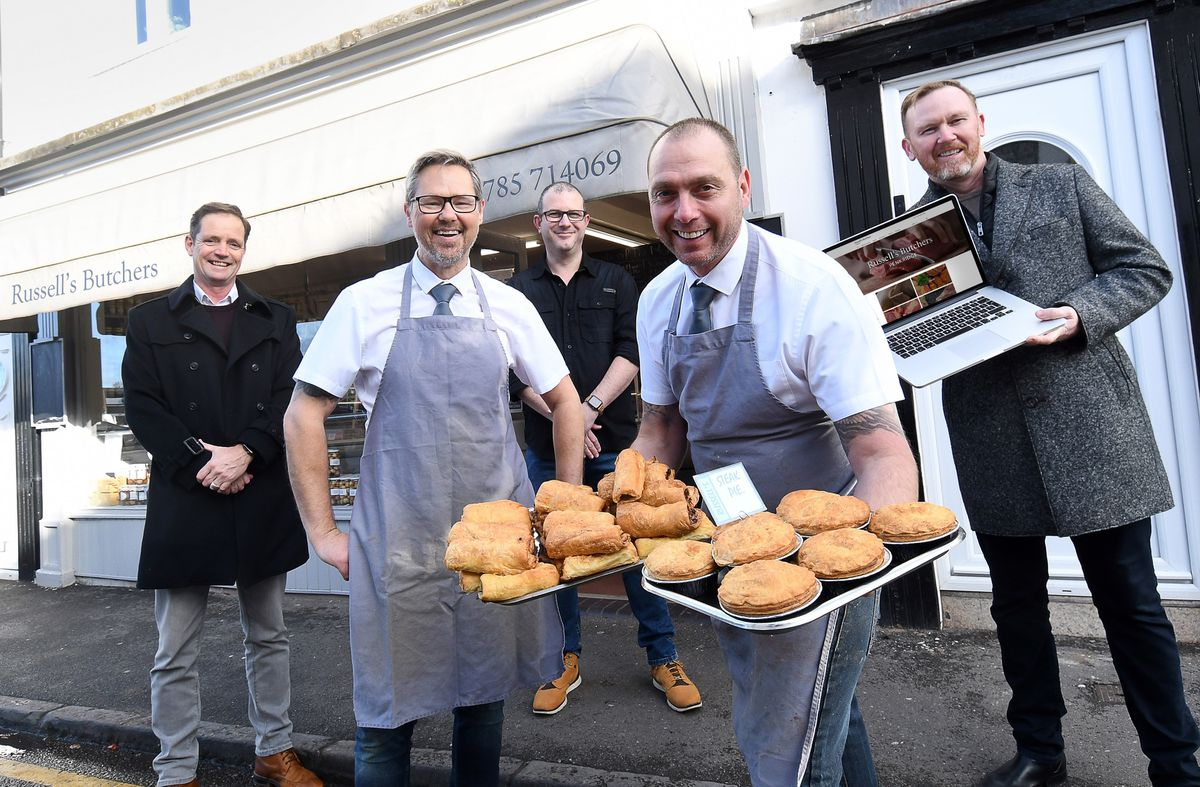 Pictured (from left) at the launch of Ourlocal.uk's drive to help shops survive are Russ James (Ourlocal.uk), Lee Russell (Russell's Butchers), Andi Elliott (Ourlocal.uk), Ray Quarry (Russell's Butchers), Darren Nelson (Ourlocal.uk) outside Russell's Butchers in Penkridge, Staffordshire.