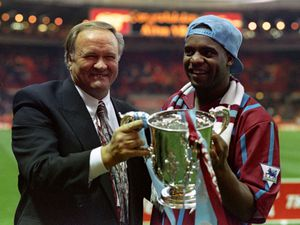Ron Atkinson and Dalian Atkinson celebrate with the Coca-Cola cup in 1994
