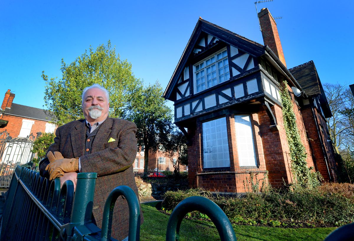 Ian McDermott, chairman of the park's friends group, next to the derelict lodge, which the group hopes to get refurbished