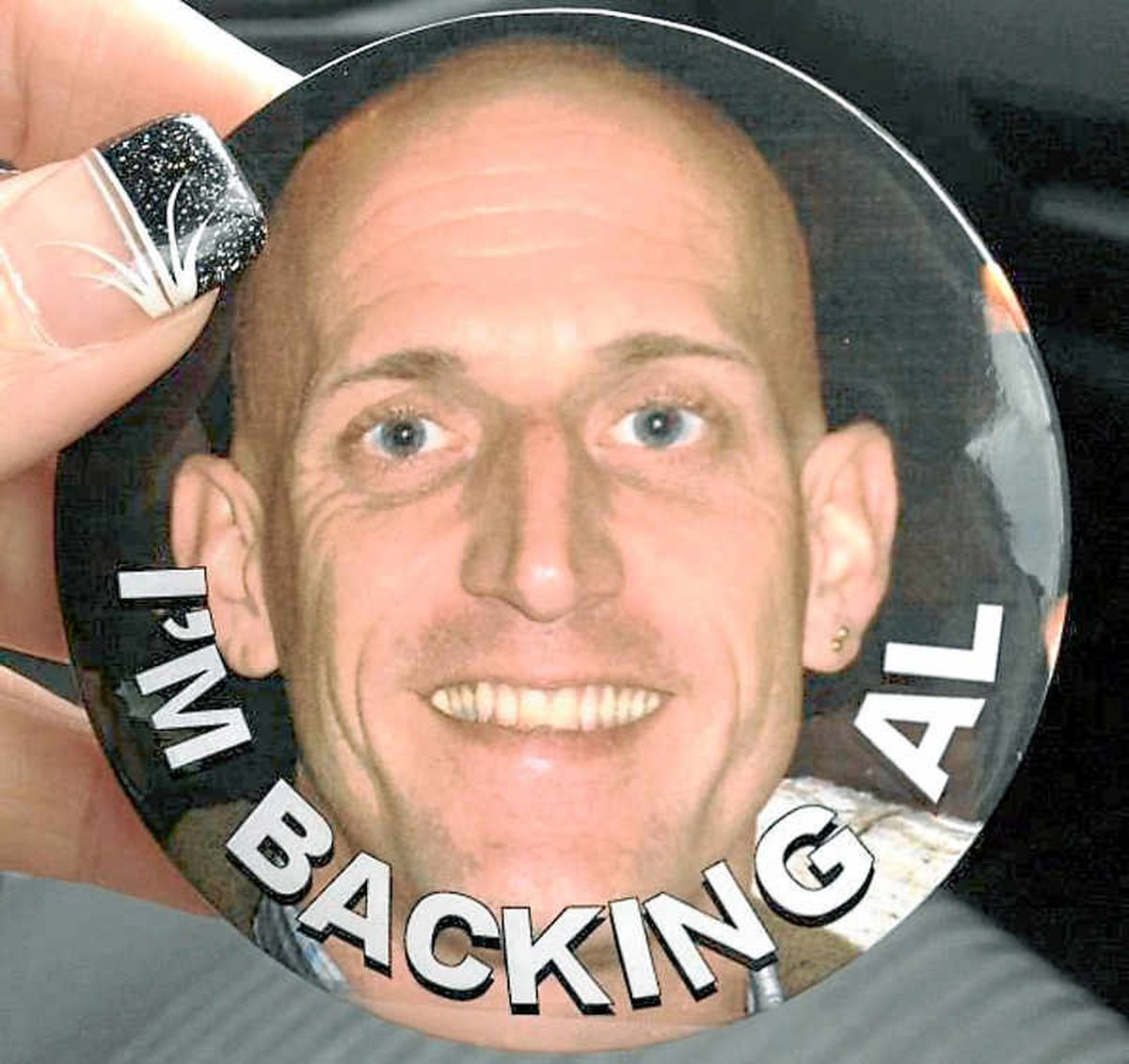 A badge with the phrase 'I'm backing Al