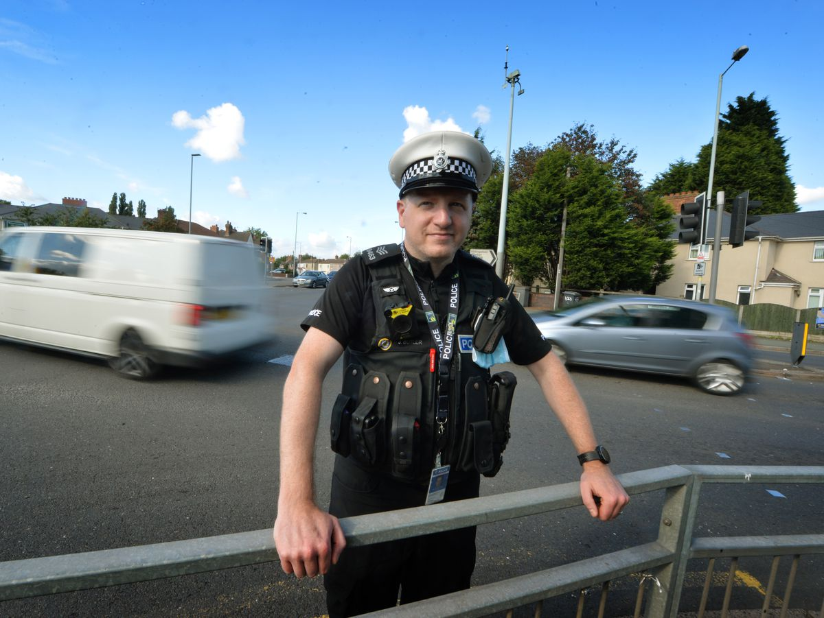 Sgt Jon Butler from the Road Harm Prevention Team marshals the scene at Parkfield Road in Wolverhampton for Operation Safer Junction