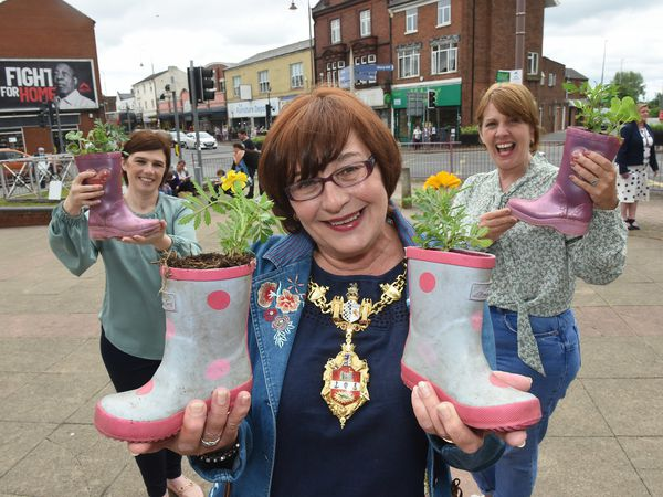 The Mayor of Dudley, Councillor Anne Millward, with the unique planters helping Brierley Hill bloom