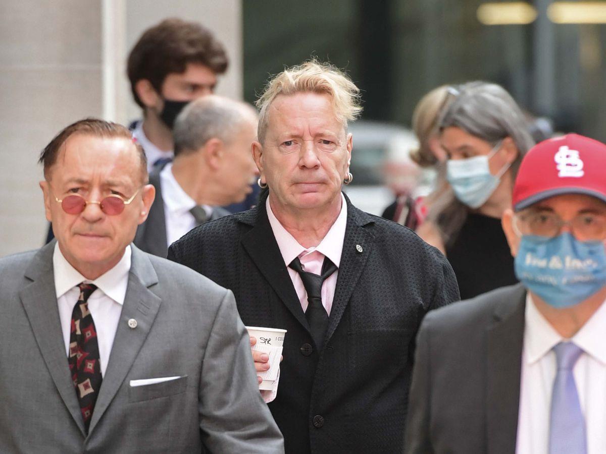 John Lydon, aka Johnny Rotten, centre, arrives at court
