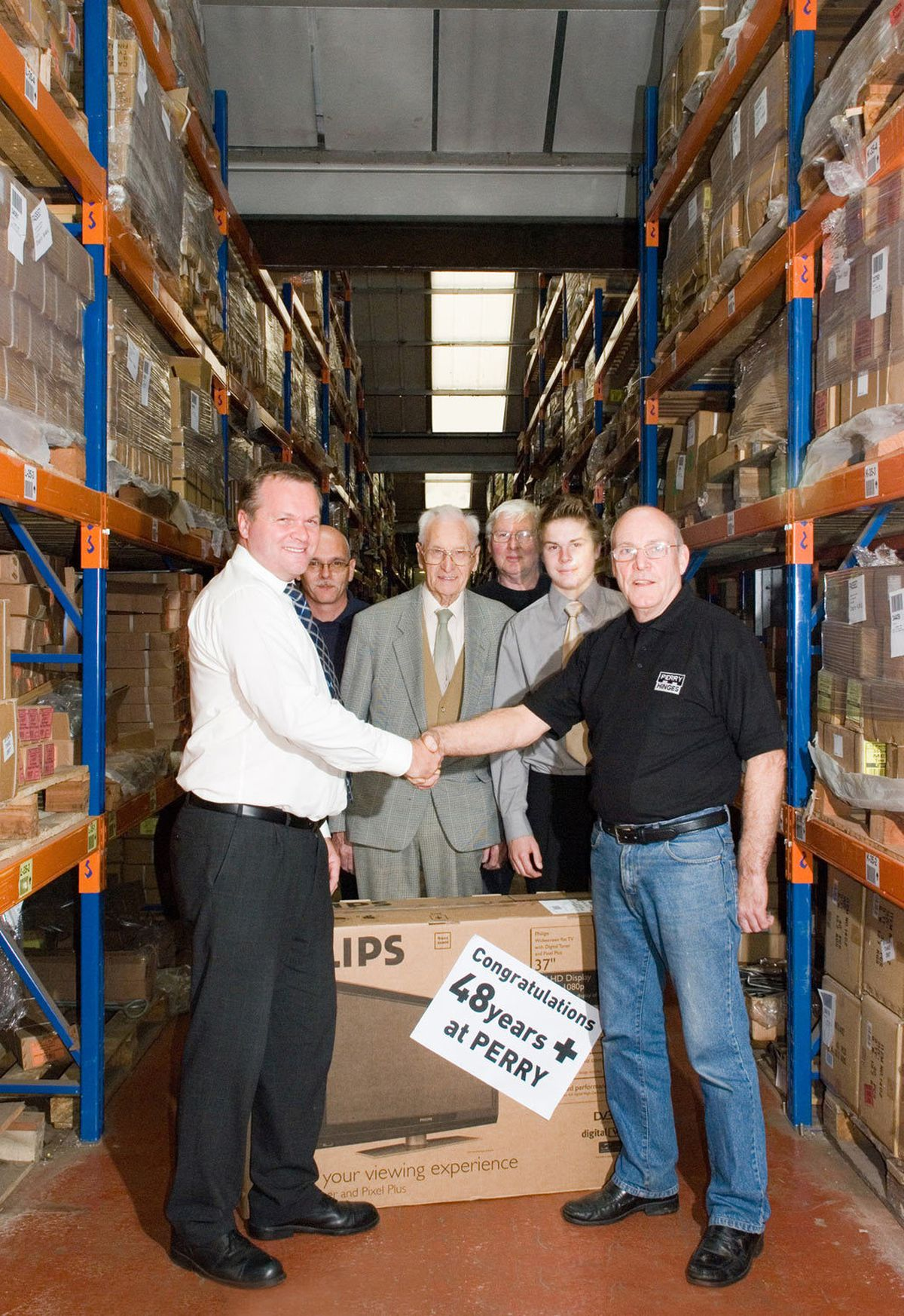 Barry Loughran, right, in 2012 when he was due to retire, with Guy Perry, operations director; Brian Lockley, works manager; Ernie Perry, chairman; Colin Clews, quality control; and Chris Perry, operations assistant