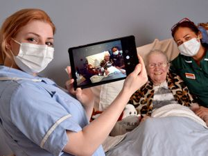 Mary Tomkins, 87, with staff members Napaporn Gregory, Emma Peniket and Penelope Midgley